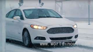 A Ford auto<em></em>nomous car driving in the snow